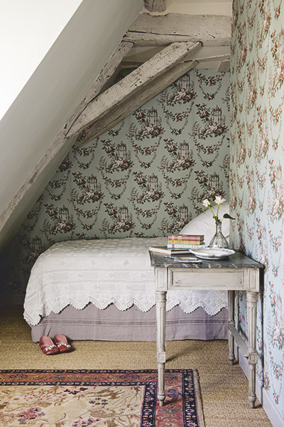 small french romantic bedroom with ornate wallpaper