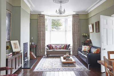 living room with bay window in a restored Victorian home