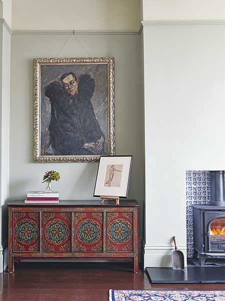 living room with painting and oriental chest in a restored Victorian semi