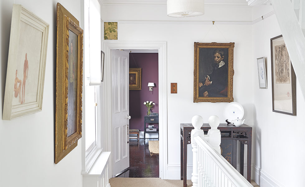 landing with paintings in a Victorian home