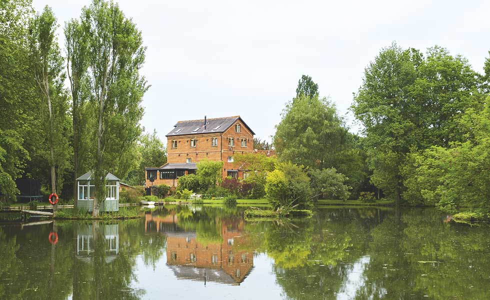 converted victorian mill house with lake