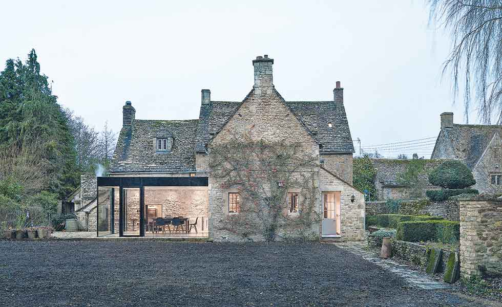 IQ Glass contemporary glazed extension to listed stone cottage