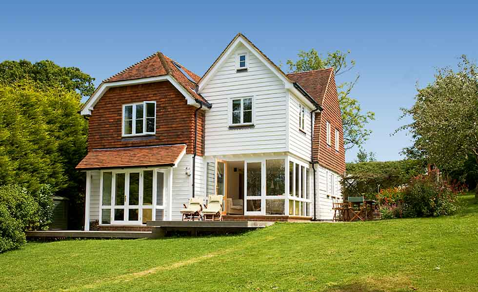 1930s Sussex house extended with traditional tile hanging and weatherboarding
