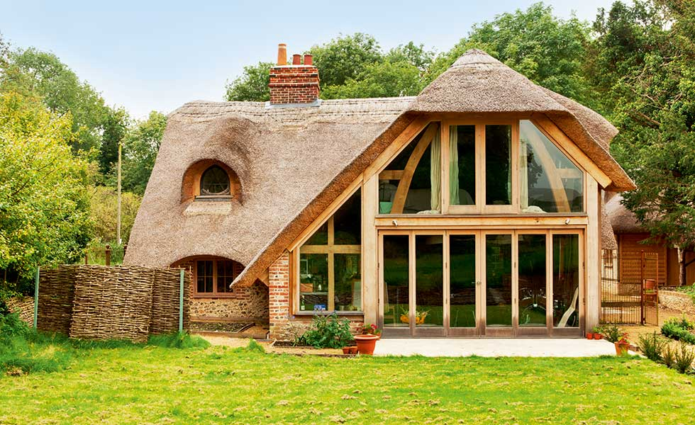 Oak frame glazed extension to 17th century listed thatched cottage