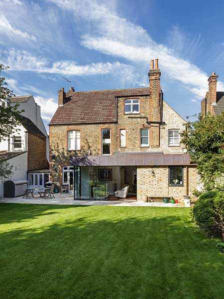 Modern copper roofed extension to late Victorian house