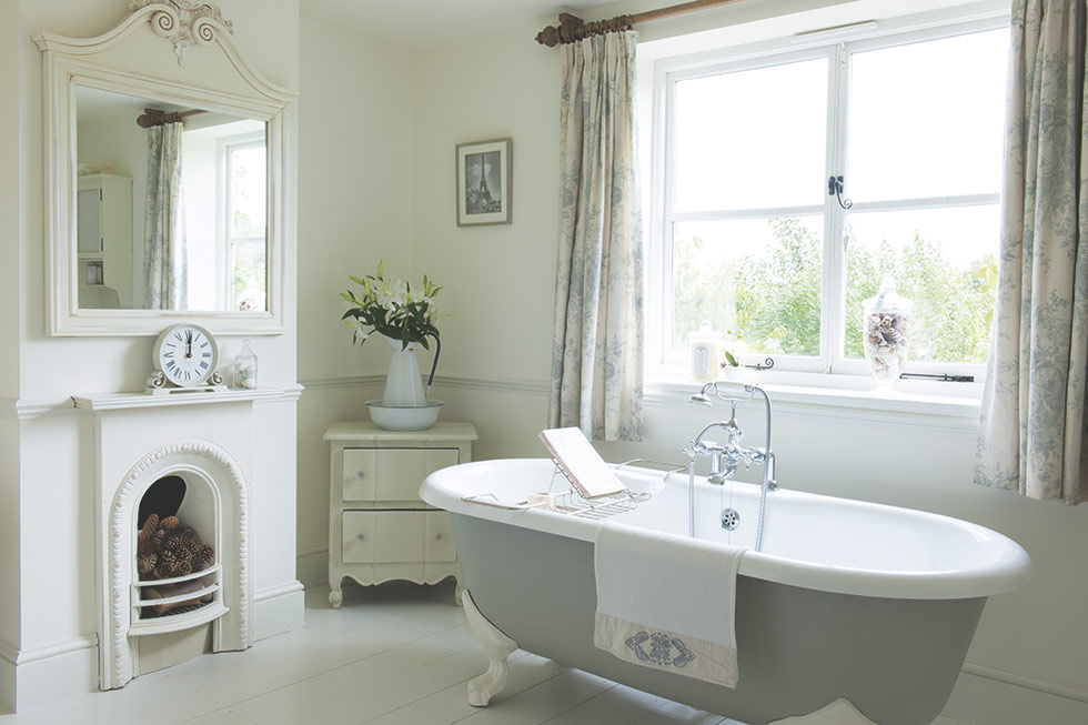 country farmhouse bathroom with grey rolltop bath