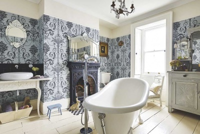 listed townhouse bathroom with rolltop and damask wallpaper