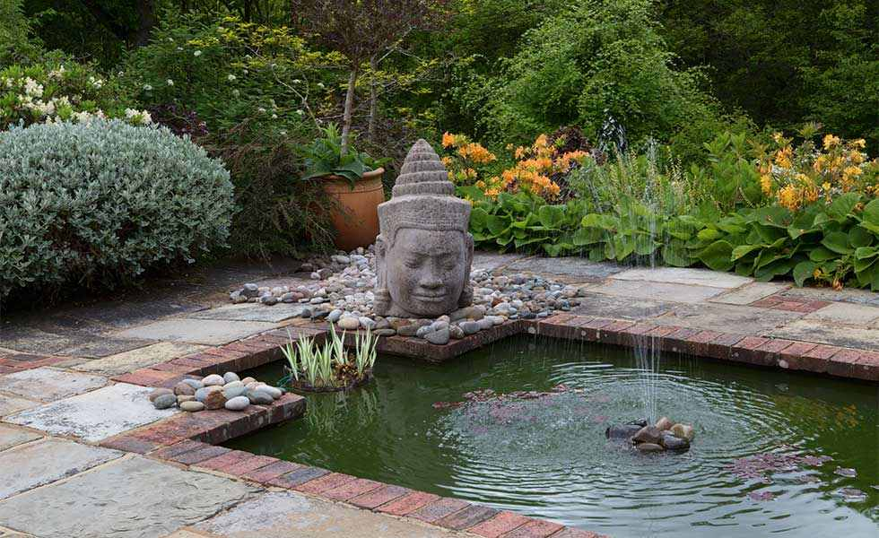 garden pond with buddha head