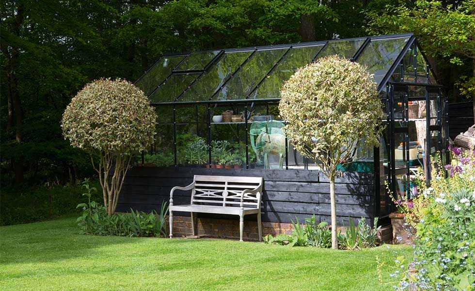 garden greenhouse with blackened cladding