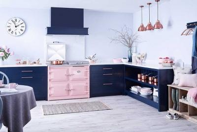 Pink Everhot range cooker in a blue kitchen