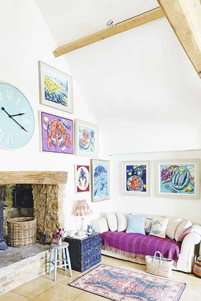 living room with paintings and open fireplace