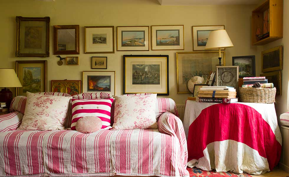 sofa in the snug with bright throw and cushions