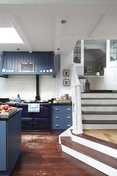 steps down to a kitchen with blue cabinets