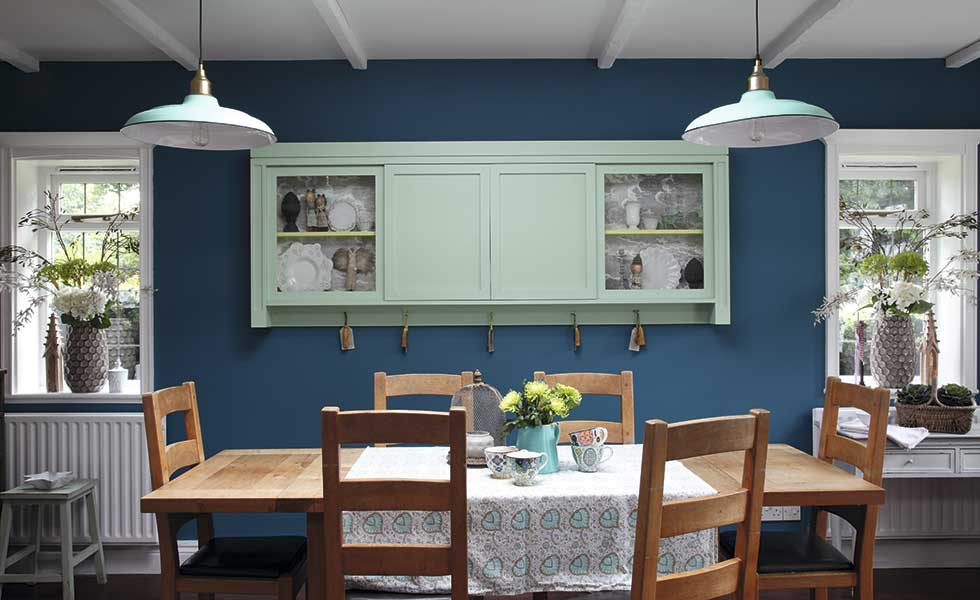 table in kitchen with blue walls