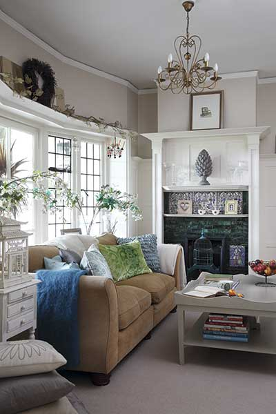 hallway seating area with original fireplace in an arts and crafts home