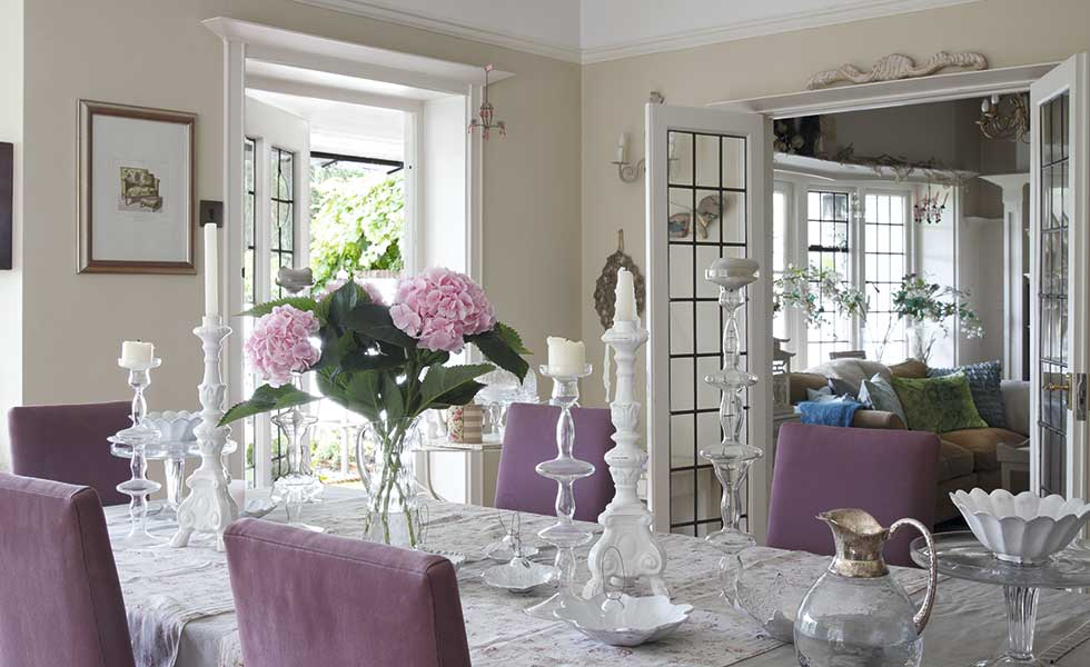 dining room with pink chairs and french doors