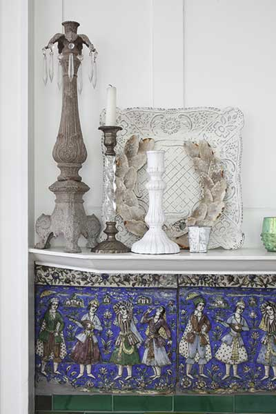 arts and crafts tiles detail with candlesticks