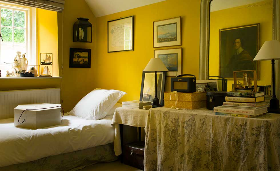 guest room with yellow walls