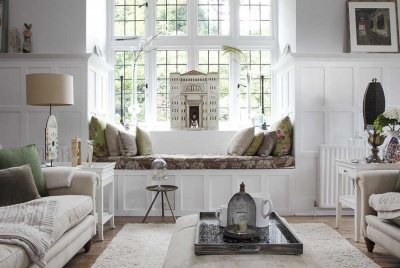 living room with white bay window and window seat