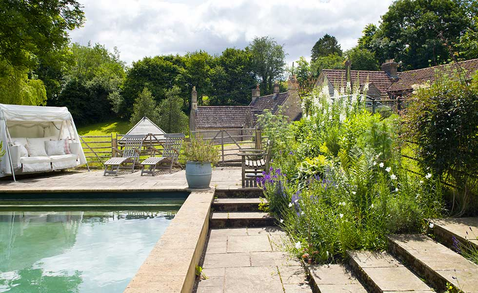 swimming pool and garden swing in mill cottage garden