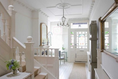 Hallway in period home with decorative mouldings