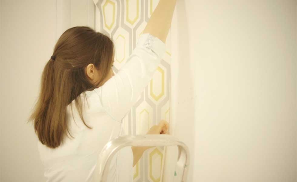 Line first piece of wallpaper up and apply with a brush