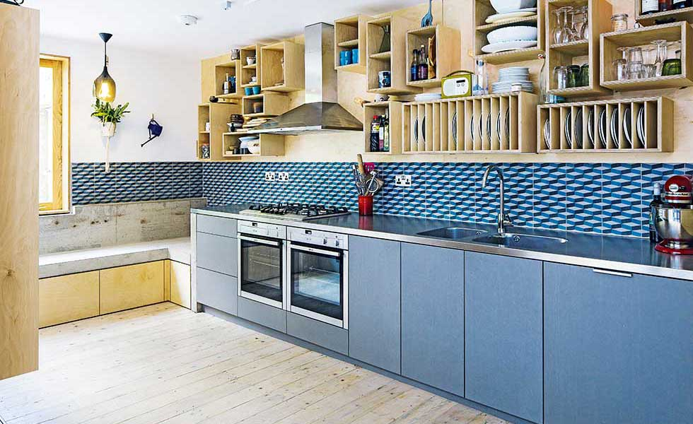 blue tiled kitchen with added value
