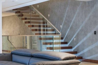 canal engineering architectural cantilever floating staircase light beams grey leather sofa
