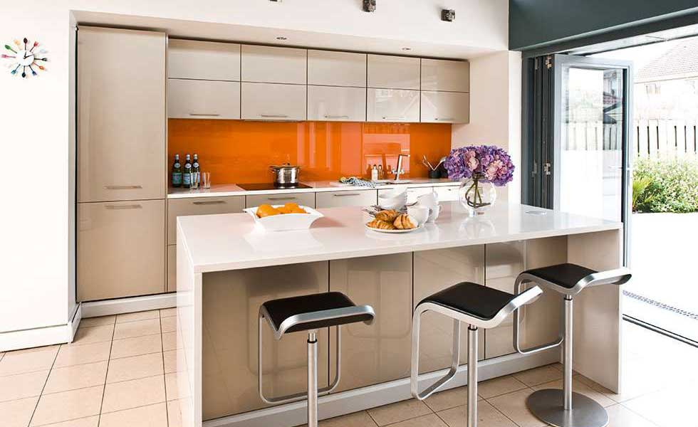 gloss orange wall in a family kitchen