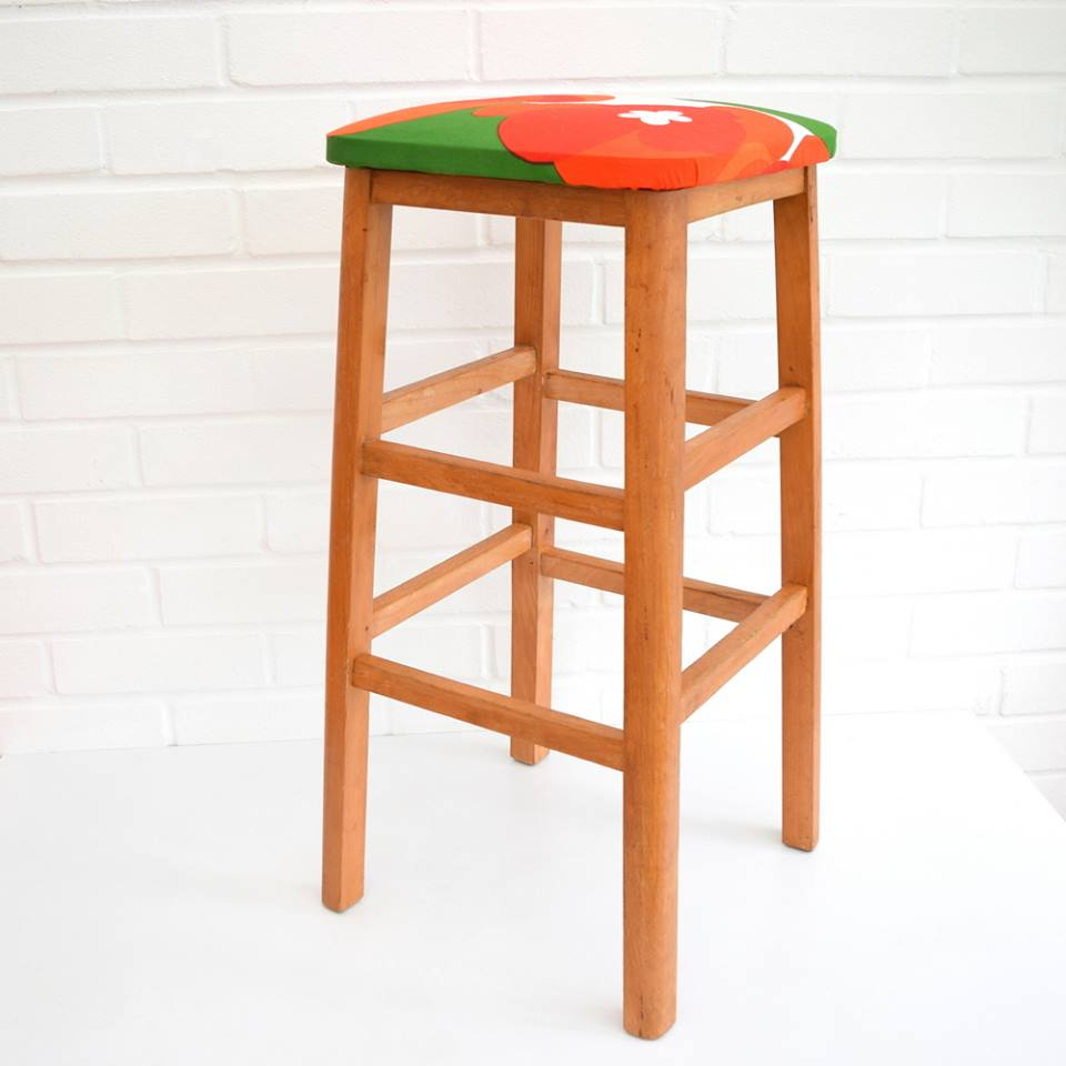Vintage stool covered in fabric