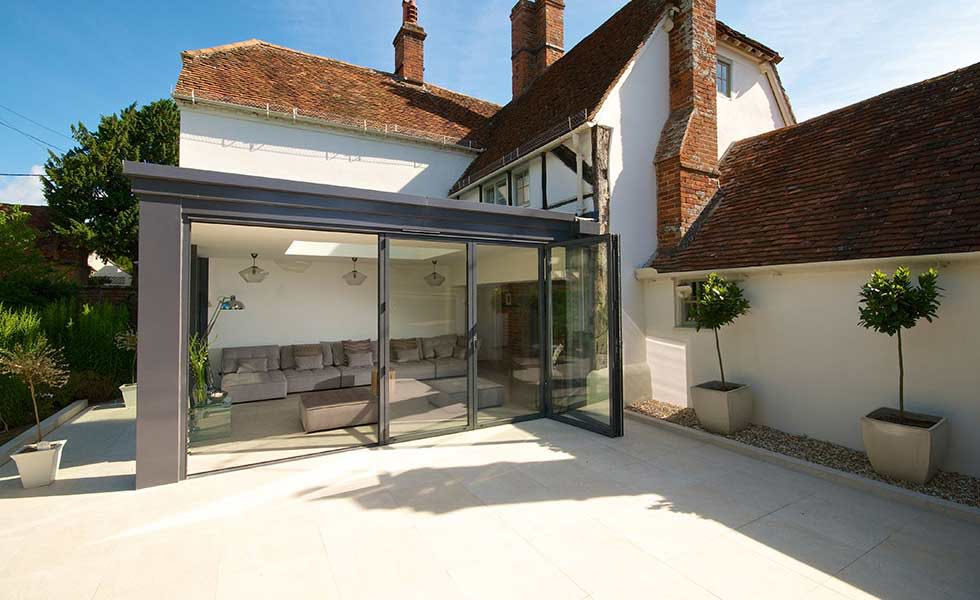 glass-extension-to-traditrional-home