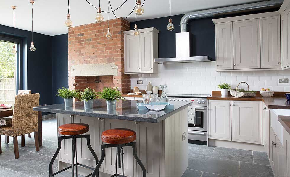 11 industrial style kitchens real homes for Industrial style kitchen