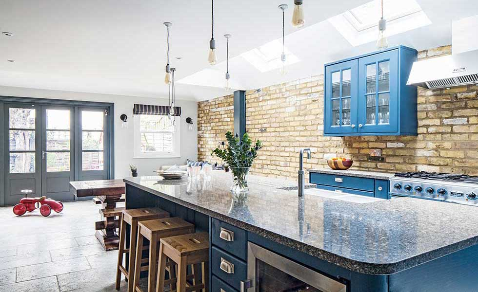 industrial style kitchen extension with exposed brick wall