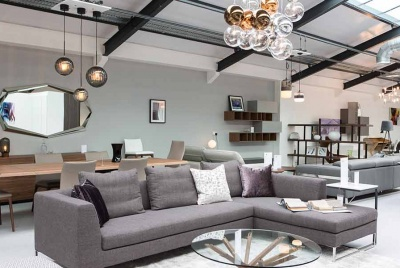 The IQ Furniture showroom includes living sets for living rooms, dining rooms and bedrooms