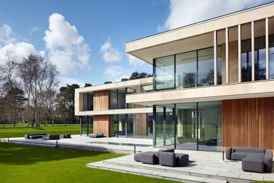 Glass sliding doors were installed surrounding this new build in Surrey to maximise natural light intake