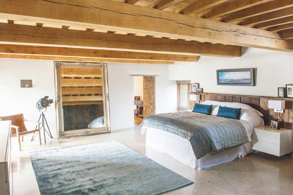 Scandinavian style bedroom in a medieval barn