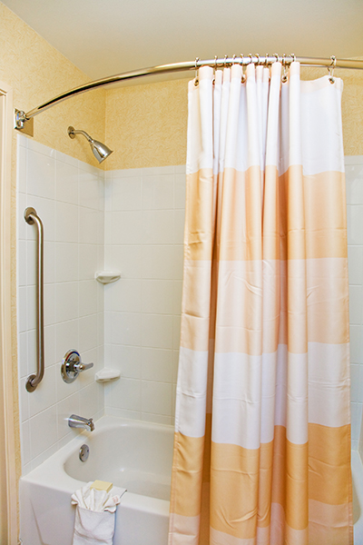 Shower with open curtain.