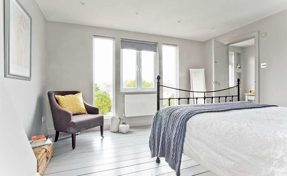 Floor-to-ceiling glazing maximises views in a loft conversion
