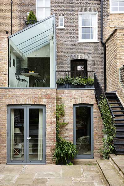 Two storey terrace house extension by Trombie