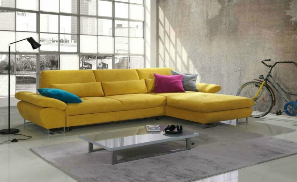 The Bardo Modern Fabric Corner Sofa Bed in yellow, includes storage and has a chaise lounge end. It costs £1,199.95