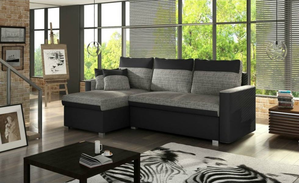 The Pescara Corner Sofa Bed is covered in black faux leather and grey fabric. It includes storage space and costs £639.95