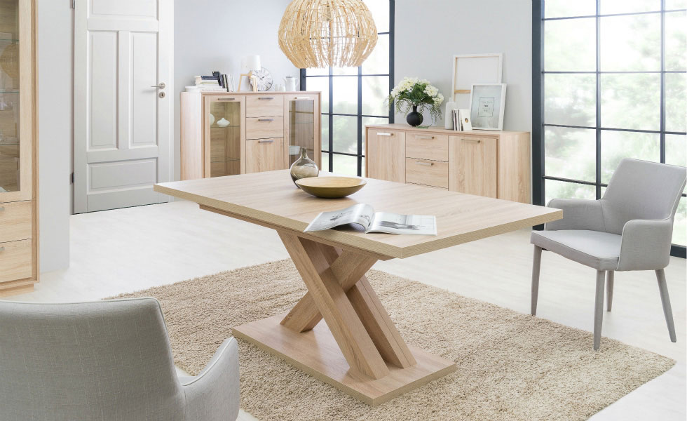 The Deluca Dining table from furnitureinfashion.net, extends from 160cm to 200cm. The central leg makes it easy to seat more guests without the limitations of corner legs. From £399.95