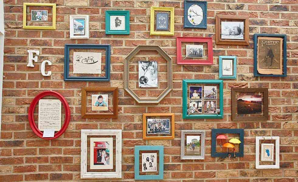 colourful picture frames in a kitchen diner