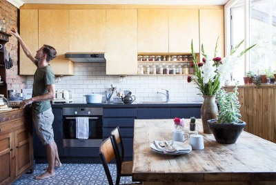 kitchen with wooden wall units and dark base units