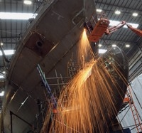 Heavy metal: Engineers at the Portsmouth shipyard working on the Trinidad and Tobago OPV Port of Spain, due to begin sea trials before the end of the year