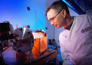 Dr Toby Jenkins uses a plasma reactor to coat the prototype dressings with the antibacterial nanocapsules.