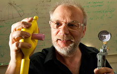 University of Chicago physicist Heinrich Jaeger uses a soft gripper to hold up a vial. The gripper consists of a rubber membrane around a granular material that can form around objects, then grab them when a vacuum pump is used to harden the material. The