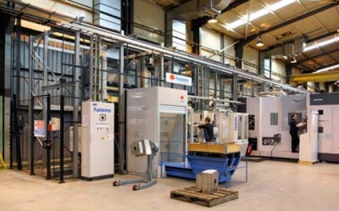 A view of the SCM machining cell at FMC Technologies, showing the Fastems storage system for machine pallets and raw material and one of the two Okuma horizontal machining centres that it serves (right)