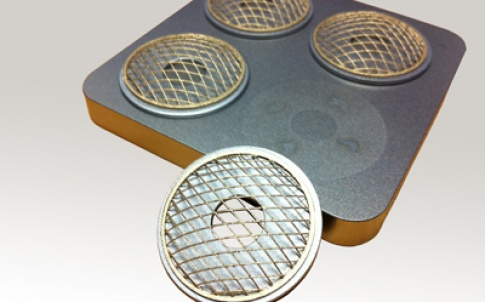 Intricate bronze mesh lattice built upon stainless steel washers using Lasercusing