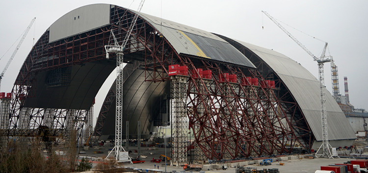 The shield is being assembled in two halves which are being joined together before being moved into place above the reactor